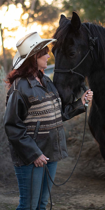 "copywriter Lorrie Morgan With Her horse ""Tude"""